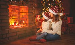 Family mother and child  daughter watching   fireplace at Christ Royalty Free Stock Photography