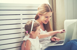 Family mother and child with laptop Stock Images