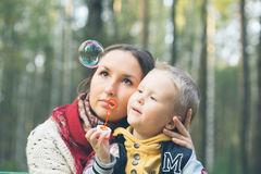 Family mother with child son in summer park. Outdoor Royalty Free Stock Photo