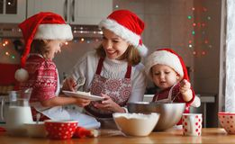 Family mother and children  bake cookies for Christmas Stock Images
