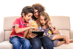 Family mother and children digital tablet Stock Photos