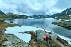 Family near Alps mountain lake Royalty Free Stock Photography
