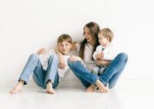 Family mother with children studio full length Stock Photo