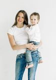 Family mother with cute baby son studio full length Stock Images