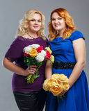 Family, mother and daughter. Attractive mother and daughter in a family photo with flowers in their hands Stock Photography