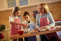 Family of mother and daughter baking cookies at home Royalty Free Stock Image