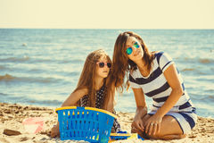 Family mother and daughter having fun on beach. Stock Photography