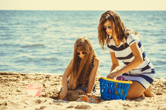 Family mother and daughter having fun on beach. Stock Image