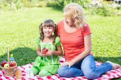 Family mother and daughter having picnic in summer Stock Photography