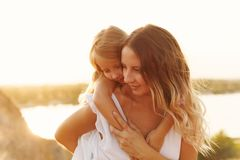 Family. Mother and daughter. Piggyback stock image