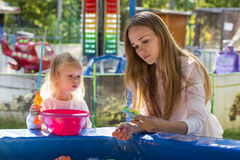 Family mother and daughter playing in park fishing Stock Photography