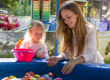 Family mother and daughter playing in park fishing Stock Image