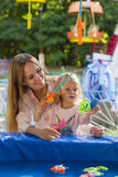 Family mother and daughter playing in park fishing Royalty Free Stock Photos
