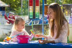Family mother and daughter playing in park fishing Royalty Free Stock Photography