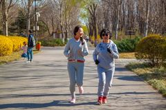 A Family, mother and daughter runner outdoors. stock photography