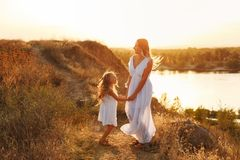 Family. Mother and daughter. By the river royalty free stock photo