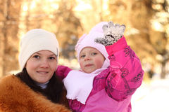 Family: mother and the daughter in the winter in park Royalty Free Stock Photo