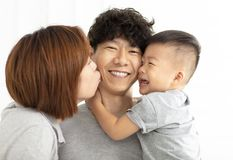 family mother, father and child kissing royalty free stock image