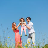 Family of mother, father and child on meadow Stock Photography