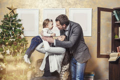 Family mother father and children with gifts in the Christmas in Stock Photography
