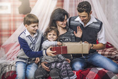 Family mother father and children give each other gifts in your Royalty Free Stock Image