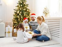 Family mother father and children at home on Christmas morning. Happy family mother father and children at home on Christmas morning Royalty Free Stock Photos