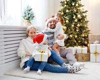 Family mother father and children at home on Christmas morning. Happy family mother father and children at home on Christmas morning Stock Photos