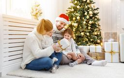 Family mother father and children at home on Christmas morning. Happy family mother father and children at home on Christmas morning Stock Image
