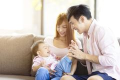 Family mother and father playing with baby at home. Happy family mother and father playing with baby at home royalty free stock photos