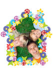 Family mother father and son. Lie on green grass Stock Photography