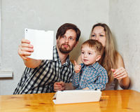 Family mother, father and son are doing selfie Royalty Free Stock Photo