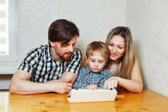 Family mother, father and son looking at tablet pc Stock Photography