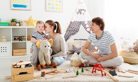 Family mother father and son playing together in children`s pl. Family mother father and baby son playing together in children`s playroom Royalty Free Stock Photography