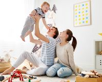 Family mother father and son playing together in children`s pl. Family mother father and baby son playing together in children`s playroom Stock Images