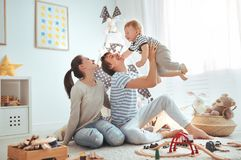 Family mother father and son playing together in children`s pl. Family mother father and baby son playing together in children`s playroom Stock Photo