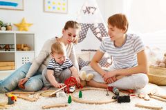 Family mother father and son playing together in children`s pl. Family mother father and baby son playing together in children`s playroom Royalty Free Stock Image