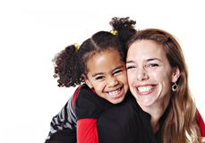A family mother with girl child posing on a white background studio stock images