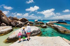Family enjoying beach view. Family of mother and kids at The Baths beach area major tourist attraction at Virgin Gorda, British Virgin Islands, Caribbean Royalty Free Stock Image