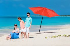 Mother and kids on a tropical beach Stock Images