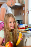 Family - mother making breakfast for school Stock Image