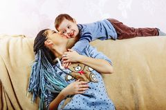 Family, Mother`s Day, son, child, smile, joyful, childhood,. Happy little boy playing with his mom, close up, copy space stock photo