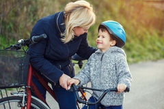 Family of mother and son biking Royalty Free Stock Photography