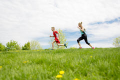 Family, mother and son are running or jogging for sport outdoors. A Family, mother and son are running or jogging for sport outdoors Stock Photo