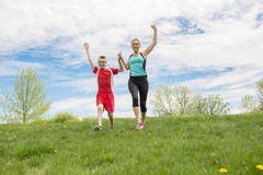 Family, mother and son are running or jogging for sport outdoors Royalty Free Stock Photo