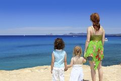 Family mother two sister daughter Cala Saona Stock Images