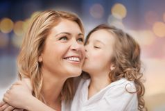 Happy mother with daughter hugging and kissing Royalty Free Stock Images