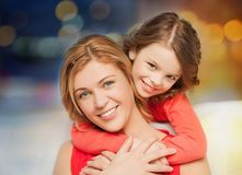 Happy mother and daughter hugging Stock Images