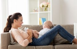Happy mother with little baby boy at home royalty free stock image