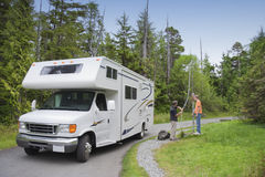 Family with Motor Home at Dumping Station. Family filling Freshwater in Motor Home at Dumping Station - Pacific Rim National Park, Vancouver Island, British royalty free stock photography