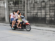Family on a Motorbike Royalty Free Stock Image